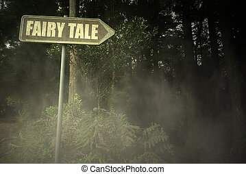 old signboard with text fairy tale near the sinister forest...