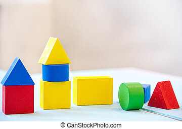 House made of old cubes. Wooden colorful building blocks....