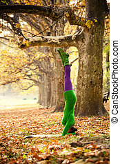 woman practice head stand outdoor - young woman practice...