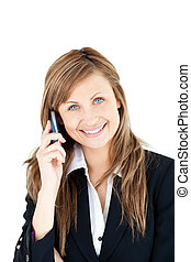 Elegant young businesswoman talking on phone smiling at the...