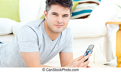 young man with phone at home