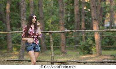 Sexy Woman Casual Style - Young hot woman standing at fence....