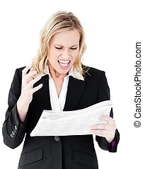 Aggressive businesswoman looking at a newspaper shouting...