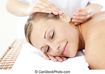 Relaxed woman receiving an acupuncture treatment