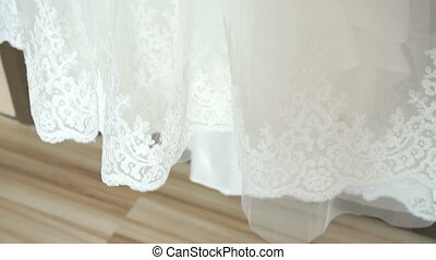 Wedding dress hanging on a shoulders indoors. Wedding...