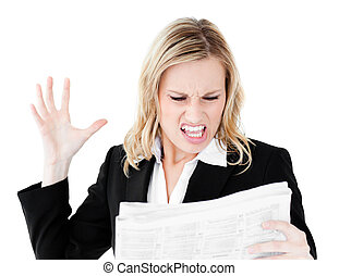Angry businesswoman looking at a newspaper shouting