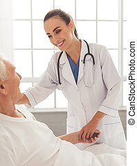 Beautiful doctor and patient - Beautiful female doctor in...