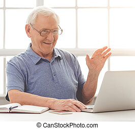 Old man with gadget - Handsome old businessman in casual...