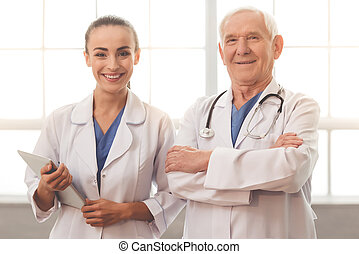 Old and young doctors - Handsome old doctor and beautiful...