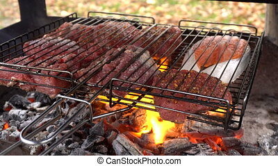 Meat and fish grilling on barbecue. Preparing tasty meat...