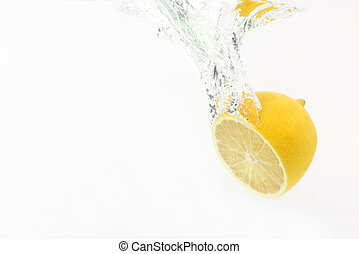 lemon drops of water on white background