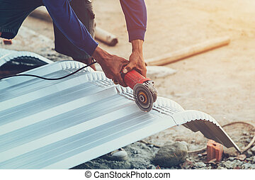 close up hand man use steel cutting to roof metal