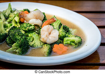 Fried brocoli with shrimp in White ceramic dish