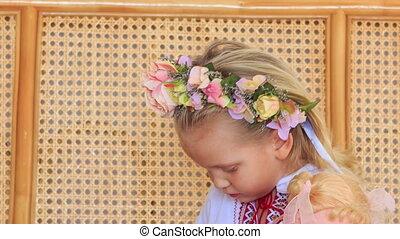 Closeup Little Blond Girl in Garland