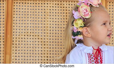 Closeup Little Blond Girl in Ukrainian Garland Speaks -...