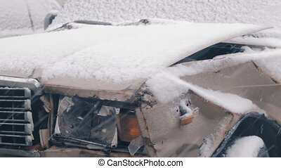 Broken in accident car covered with snow - Broken in the...