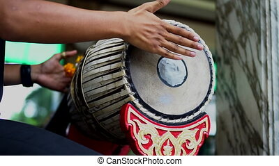 Musician playing 2 faces drum, Thai traditional musical...