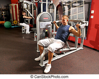 The man in fitness centre - The attractive young man in...