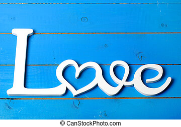 Love wooden letters on a wooden background old retro vintage...
