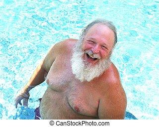 An Elderly Man Enjoys A Swim - An elderly man who looks alot...
