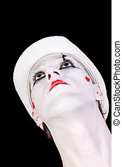 mime in white hat isolated on black background