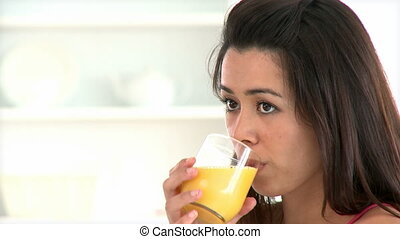 Young asian woman drinking juice