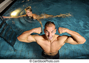The man in swimming pool - The young attractive man in...