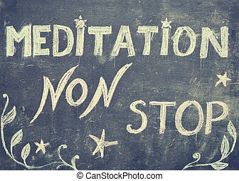 Meditation non stop sign, message written with chalk on...