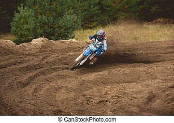 Moto cross - MX girl biker at race in Russia - a sharp turn and the spray of dirt