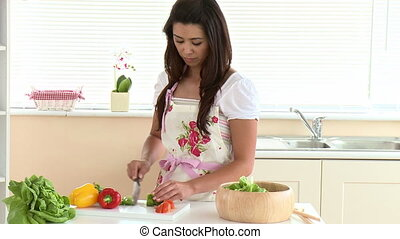 Concentrated asian woman with salad
