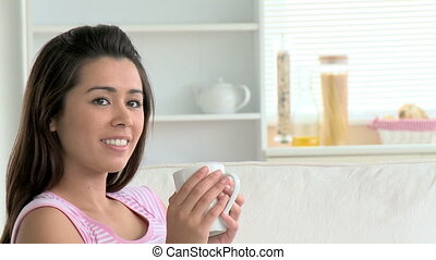 Charming asian woman with coffee