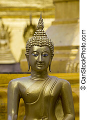 Image of golden buddha statue in temple in province tak....