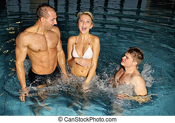 In swimming pool - The young beautiful people in swimming...