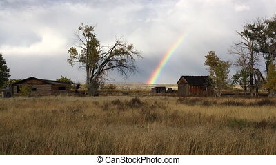Rural Landscape - steady Shot - Rainbow over the old farm...
