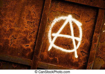 Anarchy symbol graffiti spray painted on grunge corroded...