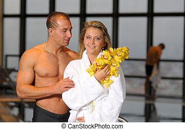 The pair - The young beautiful pair with flower in swimming...