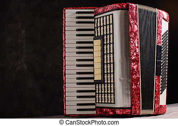 Mother of pearl accordion on a black background.