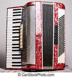 Mother of pearl accordion on a gray background.