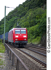 red train on the border of the rhine