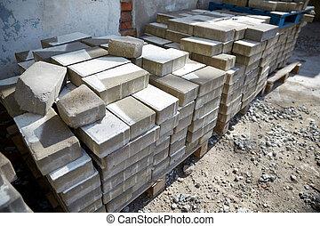 bricks batch on wooden storage pallet - brickwork,...
