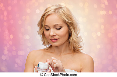 middle aged woman with cream jar - beauty, people, skincare...