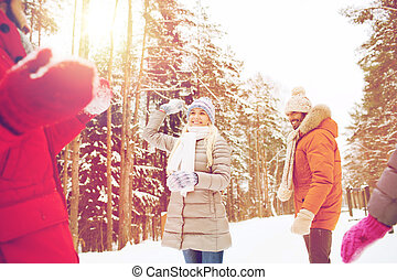 happy friends playing snowball in winter forest - christmas,...