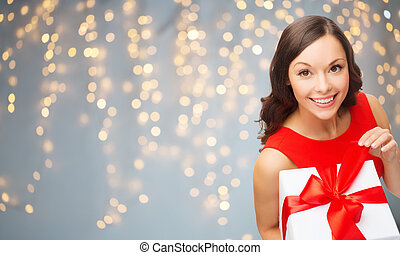 smiling woman in red dress with gift box - christmas,...