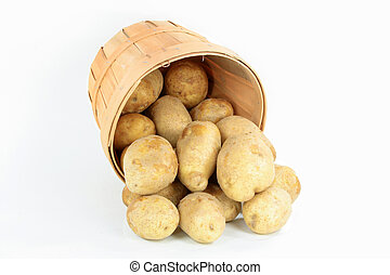 Potatoes. - Still picture of spilled from wooden basket...