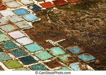 Colorful Old Mosiac Tiles on Sandy Outdoor Garden Path -...