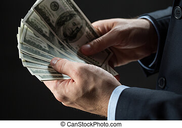 close up of businessman hands holding money - people,...