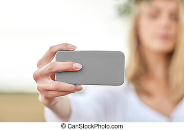 close up of woman taking selfie by smartphone