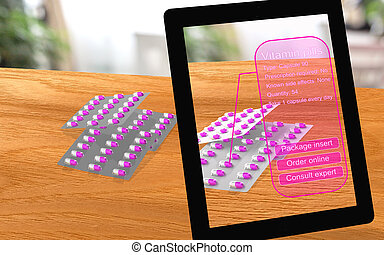 Augmented reality vitamin pills seen through a tablet with...