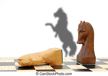 Chess challenge - Two chess pieces in combat with a shadow...