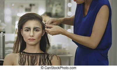 Professional make up artist working on a model - gothic...